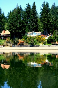 View of Agate Beach House from a boat in Hammersley Inlet.